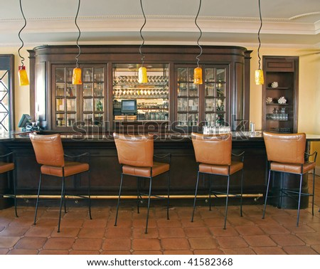 chic retro bar with leather chairs - stock photo