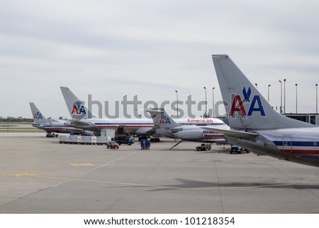 CHICAGO-APR 21: American Airlines aircraft at the Chicago Ohare airport in Chicago, Illinois on April 21, 2012. American Airlines has around 900 aircraft and serves 250 cities in 50 countries with 3,400 daily flights. - stock photo