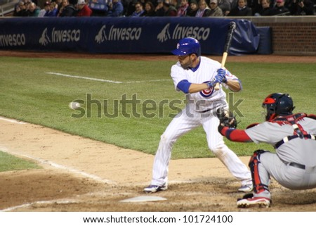 CHICAGO - APRIL 25: David DeJesus of the Chicago Cubs prepares to hit a ball against the St. Louis Cardinals at Wrigley Field on April 25, 2012 in Chicago, Illinois. - stock photo
