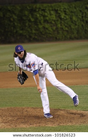 CHICAGO - APRIL 25: James Russell of the Chicago Cubs pitches against the St. Louis Cardinals at Wrigley Field on April 25, 2012 in Chicago, Illinois.