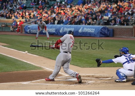 CHICAGO - APRIL 25: Matt Holliday of the St. Louis Cardinals hits a ball during a game against the Chicago Cubs at Wrigley Field on April 25, 2012 in Chicago, Illinois. - stock photo