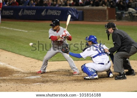 CHICAGO - APRIL 25: Rafael Furcal of the St. Louis Cardinals hits a ball during a game against the Chicago Cubs at Wrigley Field on April 25, 2012 in Chicago, Illinois. - stock photo