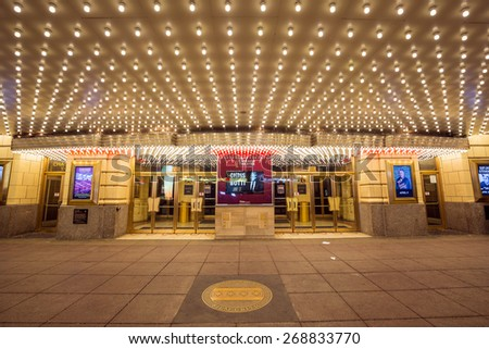 CHICAGO - April 8: The famous Chicago Theater on State Street onApril 8, 2015 in Chicago, Illinois. Opened in 1921, the theater was renovated in the 1980's at a cost of $4.3 million. - stock photo