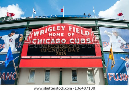 CHICAGO - APRIL 8: The Wrigley Field marque in Chicago welcomes fans to the 2013 Major League Baseball home opener on April 8, 2013. - stock photo