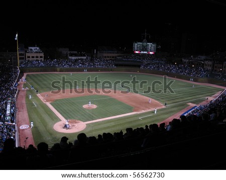 CHICAGO - APRIL 26: Wrigley Field during a night game pitting the Cubs against the Washington Nationals on April 26, 2010 in Chicago, Illinois. - stock photo