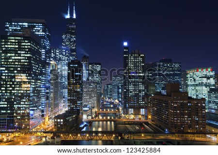 Chicago at night. Image of Chicago downtown and Chicago River with bridges at night. - stock photo