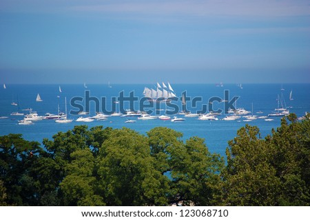 CHICAGO - AUGUST 23: Boats gather together on Lake Michigan to watch the Chicago Air and Water Show on August 23, 2010 in Chicago, Illinois. The show lasts for two days. - stock photo