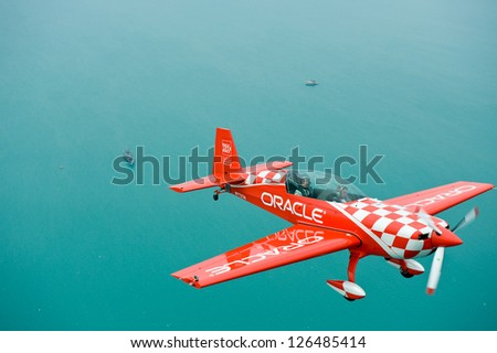 CHICAGO - AUGUST 16: Sean Tucker of Team Oracle flies over Lake Michigan during the Chicago Air and Water Show Media Day on August 16, 2012 in Chicago. - stock photo