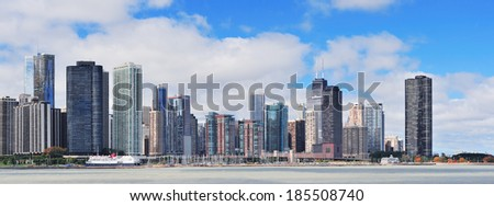 Chicago city urban skyline panorama with skyscrapers over Lake Michigan with cloudy blue sky. - stock photo