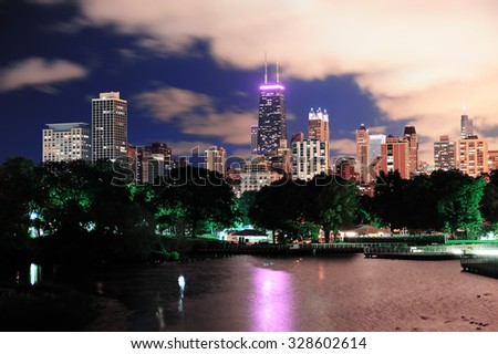 Chicago city urban skyscraper at night over lake viewed from Lincoln Park. - stock photo