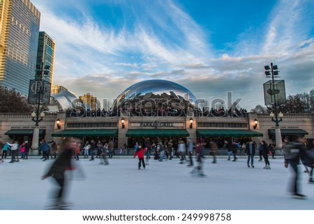 CHICAGO - December 23 2014: Ice skating people at McCormick Tribune Plaza with Cloud Gate sculpture in the background in Chicago, IL - stock photo