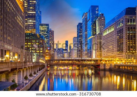 Chicago downtown and Chicago River at night in USA. - stock photo