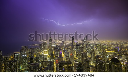 Chicago downtown night panorama during thunderstorm - stock photo