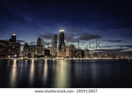 Chicago Downtown skyscrapers with reflections in Lake Michigan at night