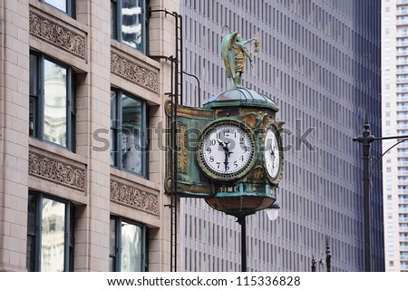 Chicago downtown street view with old fashion clock and skyscraper building. - stock photo