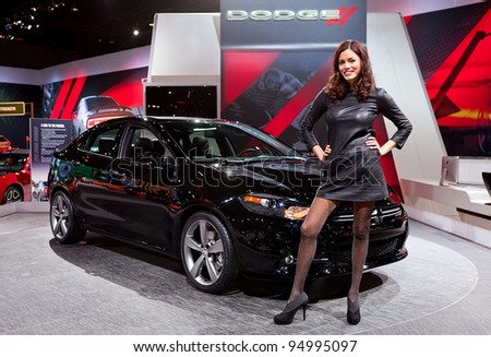 CHICAGO - FEB 8: A model poses with the all new 2013 Dodge Dart on display at the 2012 Chicago Auto Show Media Preview on February 8, 2012 in Chicago, Illinois. - stock photo