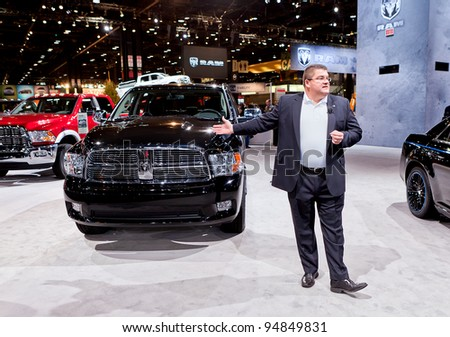 CHICAGO - FEB 9: A Mopar executive talks about the customizations to a Dodge Ram truck at the 2012 Chicago Auto Show Media Preview on February 9, 2012 in Chicago, Illinois.