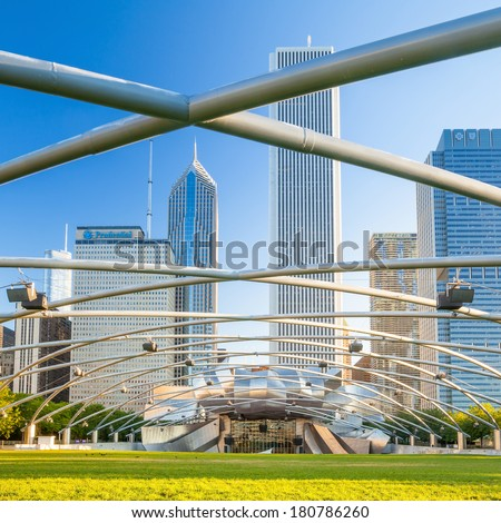 CHICAGO-FEB 09:Jay Pritzker Pavilion with high modern buildings in winter at Millennium Park on February 09, 2014 in Chicago, IL USA. Pavilion hosts concerts and events by capacity for 11,000 people.