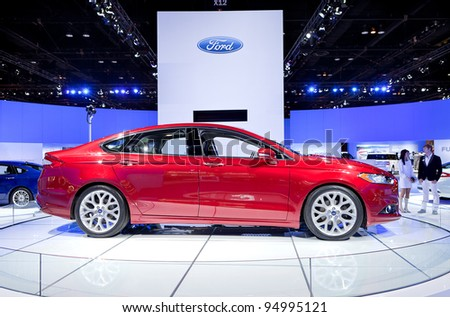 CHICAGO - FEB 8: The 2013 Ford Fusion Hybrid on display at the 2012 Chicago Auto Show Media Preview on February 8, 2012 in Chicago, Illinois. - stock photo