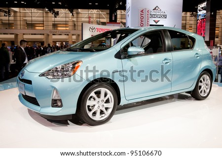 CHICAGO - FEB 12: The 2013 Toyota Prius C on display at the 2012 Chicago Auto Show. February 12, 2012 in Chicago, Illinois. - stock photo