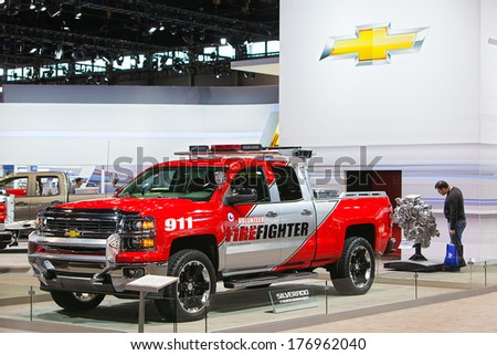 CHICAGO - FEBRUARY 7 : A Chevy Silverado volunteer firefighter truck on display at the Chicago Auto Show media preview February 7, 2013 in Chicago, Illinois. - stock photo