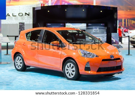 CHICAGO - FEBRUARY 8 : A Toyota Prius C on display at the Chicago Auto Show media preview February 8, 2013 in Chicago, Illinois. - stock photo
