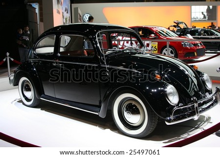 """CHICAGO - FEBRUARY 18 :""""Max"""" the Volkswagen Beetle 1964 that is the new spokesperson for the brand Das Auto campaign was displayed at the Autoshow 2009 on Febraury 18, 2009  in Chicago,IL - stock photo"""