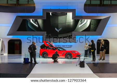 CHICAGO - FEBRUARY 7 : Members of the press inspect the new Chevrolet Corvette Concept at the Chicago Auto Show media preview February 7, 2013 in Chicago, Illinois. - stock photo