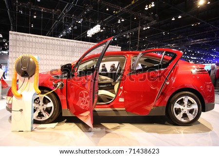 CHICAGO - FEBRUARY 15: The Chevy Volt presentation at the Annual Chicago Auto Show on February 15, 2011 in Chicago, IL. - stock photo