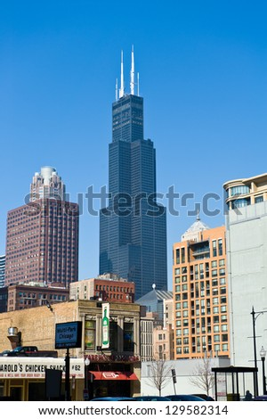 CHICAGO - FEBRUARY 25: Willis Tower and surrounding skyline on February 25, 2013 in Chicago. Formally known as Sears Tower, Willis Tower is the tallest building in the United States. - stock photo