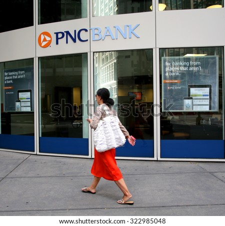 CHICAGO - FRIDAY, SEPTEMBER 25, 2015: Pedestrians walk past a PNC Bank in Chicago. PNC Financial Services Group, Inc. is an American financial services corporation    - stock photo