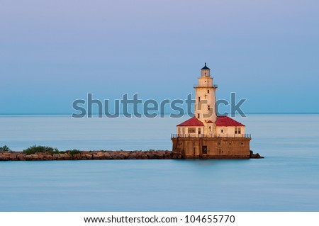 Chicago Harbor Light. Image of the Chicago lighthouse at sunset. - stock photo