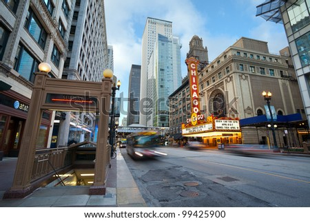 CHICAGO, IL - APRIL 5: Chicago Theater and street view on April 5, 2012 in Chicago, Illinois.The Chicago Theater is a landmark theater located on North State St. in the Loop area of Chicago, Illinois. - stock photo