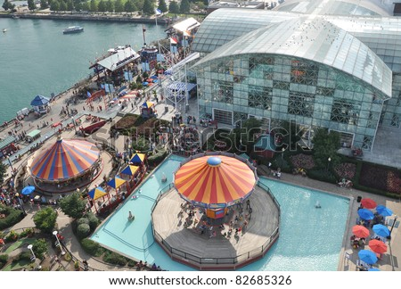 CHICAGO, IL - AUG 7: Every year millions of tourists visit Chicago's Navy Pier, a 3,300 ft long pier on the Chicago shoreline of Lake Michigan in the Streeterville area, Chicago, August 7, 2010. - stock photo