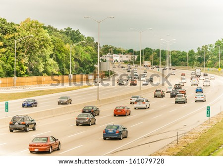 Chicago, IL - AUG 31: Start of evening rush hour congestion in Chicago suburb on August 31st 2013. Chicago Area Ranks 7th for Worst Traffic Congestion resulting in lost productivity and health issues. - stock photo