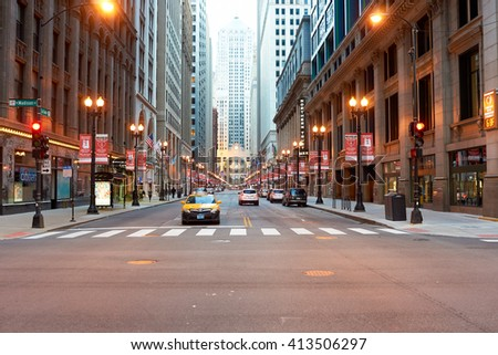 "CHICAGO, IL - CIRCA APRIL, 2016: streets of Chicago at evening. Chicago, colloquially known as the ""Windy City"", is the third most populous city in the USA, following New York and Los Angeles"