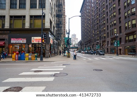 "CHICAGO, IL - CIRCA MARCH, 2016: streets of Chicago at daytime. Chicago, colloquially known as the ""Windy City"", is the third most populous city in the USA, following New York City and Los Angeles"