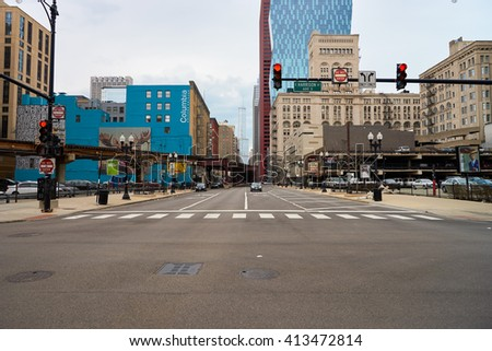 """CHICAGO, IL - CIRCA MARCH, 2016: streets of Chicago at daytime. Chicago, colloquially known as the """"Windy City"""", is the third most populous city in the USA, following New York City and Los Angeles - stock photo"""