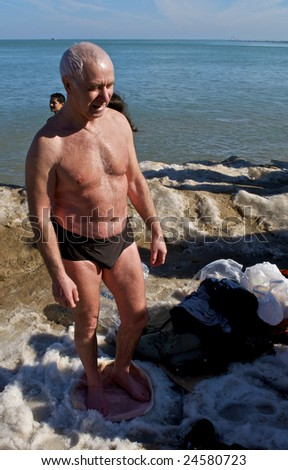 CHICAGO, IL - FEBRUARY 7: A swimmer warms following the Lakeview Polar Bear Club's 8th Annual polar plunge on February 7, 2009 at Oak Street Beach in Chicago, IL - stock photo