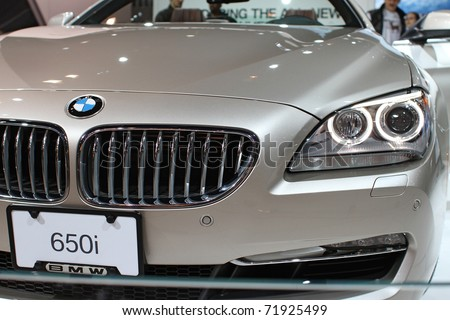 CHICAGO, IL - FEBRUARY 20: BMW 650i model 2011 on display at the International auto-show on February 20, 2011 in Chicago, IL - stock photo