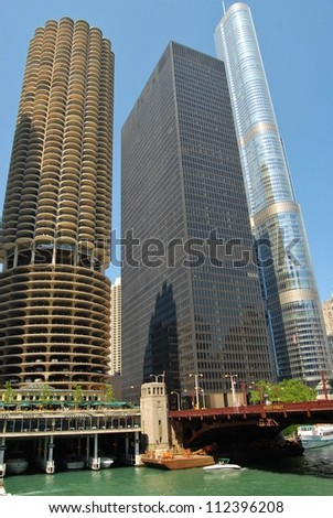 CHICAGO, IL - JUNE 25: Marina City Complex, and Modern Buildings on June 25 , 2011 in Chicago,USA.  Apartments, offices, restaurants, banks,  theater 18 stories of parking space at Downtown Chicago. - stock photo