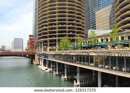 CHICAGO, IL - JUNE 25: Marina City Complex, and Modern Buildings on June 25 , 2011 in Chicago,USA. Apartments, offices, restaurants, banks, theater 18 stories of parking space at Downtown Chicago - stock photo