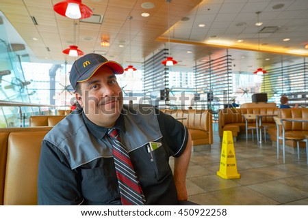 CHICAGO, IL -  MARCH 31, 2016: inside portrait of the worker in the Rock N Roll McDonald's. The Original Rock N Roll McDonald's is a flagship McDonald's restaurant located in Chicago, Illinois - stock photo