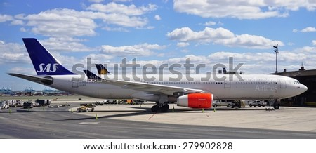 CHICAGO, IL -16 MAY 2015- An Airbus A330 from Scandinavian Airlines (SK) gets ready for takeoff at Chicago Oâ??Hare International Airport (ORD).  - stock photo