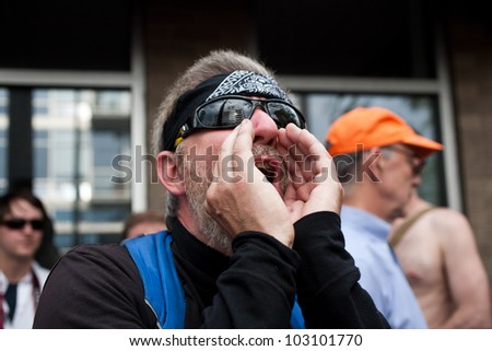 CHICAGO, IL- MAY 20: Protesters scream at police as they protest the 25th NATO Summit. The first summit to be held outside of Washington, D.C. in the United States, Chicago, Illinois, May 20-21, 2012. - stock photo