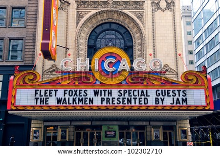 CHICAGO, IL - OCT 6: Chicago Theatre and street view on October 6, 2011 in Chicago, Illinois. The iconic Chicago Theatre marquee appears in film, television, artwork, and photography as city landmark. - stock photo