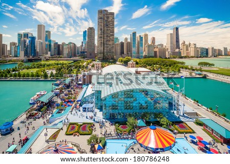 CHICAGO, IL - OCT 1: Navy Pier and skyline on October 1, 2013 in Chicago, Illinois. It was built in 1916 as 3300 foot pier for tour and excursion boats and is Chicago's number one tourist attraction. - stock photo