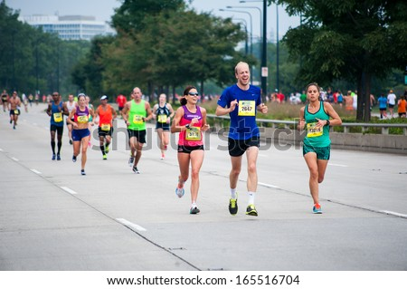 CHICAGO, IL - SEPTEMBER 8: Participants in the Chicago Half Marathon run down South Lake Shore Drive on September 8, 2013 in Chicago, Illinois. - stock photo