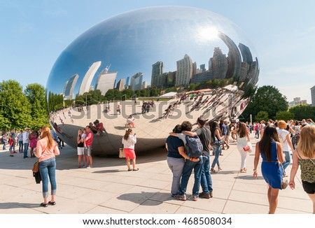 Chicago, IL, United States - August 15, 2014: Cloud Gate, one of the most unique and interesting sculptures in decades graces the promenade at Chicago's Millennium Park.