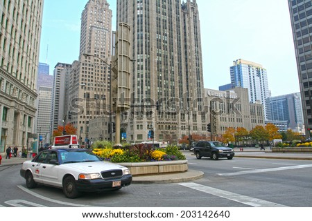 CHICAGO, IL, US - NOVEMBER 13, 2007: Taxi cabs on busy Michigan Avenue. The Windy City is the third largest city in the U.S. and is a worldwide center of commerce. - stock photo